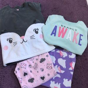 Two sets of girls pajamas